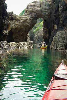 Paddling on clear water to another tunnel, Okinoshima, Japan by ippei + janine, via Flickr
