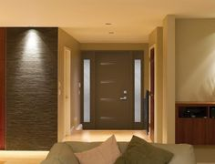 """Urbano steel door painted brown with two 7"""" x 64"""" sidelites, from NOVATECH Design Collection."""