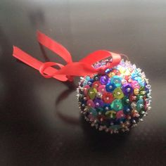 2.5 inch, light, styrofoam ball. Made with sequins and seed beads. It will look great on a tree with lights dancing on it! My thumb still hurts from pushing all the pins in, but it was worth it! I love the color and sparkle on it.