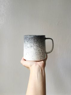 This Listing is for our brand new Appaloosa Glaze! This glaze is a lovely gradient of dark and light grey color on a cream mug. Its the perfect mug for getting cozy with on a chilly day, and its name comes from the gorgeous coloring of Appaloosa Horses. The size of these mugs ranges slightly, but generally holds 12oz. All of my work is food safe, and can be microwaved.   Paper & Clay is a small shop making small batches of handmade ceramics. My quantities are limited as I make each piece…