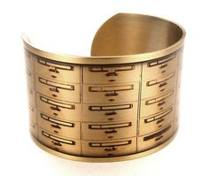 One way you can wear your library nostalgia is with this bracelet/cuff featuring an old school library catalog.