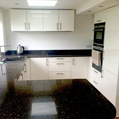 Magnolia gloss kitchen with black star galaxy granite worksurface