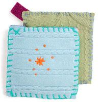 Cutie Pie Pot Holders  What you'll need:       Felted wool sweater  Rotary cutter and cutting pad  One 7-inch square of woven cotton fabric  One 1x6-inch strip of cotton jersey  Extra-long straight pins  Size 16 yarn darner needle  Persian wool or embroidery floss