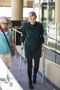 Woman on crutches Crutches, Normcore, High Neck Dress, Woman, Sexy, Dresses, Style, Fashion, Turtleneck Dress