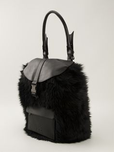 Shop Y-3 fur backpack from Farfetch