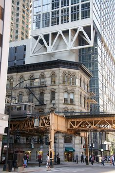 This is how Chicago really is. New architecture surrounding historical architecture, connected by the El.