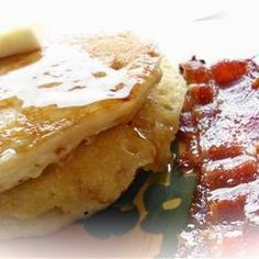 My-Hop Pancakes | These delicious breakfast cakes are said to resemble those from a famous pancake house. When replacing milk for buttermilk, increase lemon juice to 1 1/2 tablespoons. Serve topped with butter.