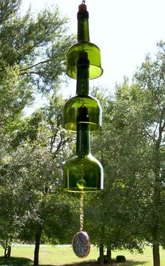 Recycled Bottle Wind Chimes.  This is not a DIY post but doesn't look that difficult