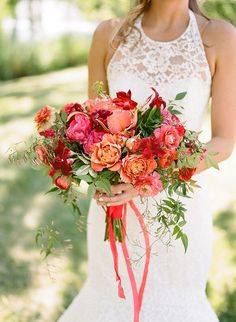 Elegant pink, red and coral bridal bouquet. Pink wedding bouquet, red wedding bouquet, coral wedding bouquet. Lace halter gown from Carolina Herrera.