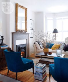 Susan traded two antique French chairs for these blue mid-century ones from her mother, which serve as a pop of colour and a modern element....