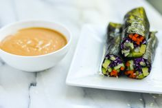 Raw vegetables wrapped in flavorful nori sheets and dipped in a sweet and tangy peanut sauce!