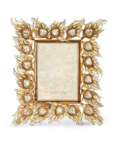 """Frame Jay Strongwater Peacock Feather 5"""" x 7"""" Frame EUR 2,134.20 is Product Price. Online Inquiries: NMF17_H7YZ6 Handcrafted photo frame. Metal. Hand enameled and hand set with Swarovski® crystals. 8.5""""W x 13""""T; holds a 5"""" x 7"""" photo. Imported. About Jay Strongwater: Jay Strongwater's love of the elegant but vividly bejeweled objet—whether it's meant to rest on a tabletop or the graceful curve of a woman's neck—has led him on a journey through the worlds of fashion and home furnishings. He…"""