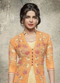 Wedding season can be a reason to explore new styles, trends and colors that you may not wear as often. Make a statement in this stylish cream and pink salwar kameez with embroidered orange long jacket style suit. Indian Suits, Indian Dresses, Indian Wear, Indian Salwar Kameez, Salwar Kameez Online, Churidar, Anarkali, Kurti, Ethnic Fashion