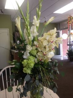 Green goddess.. Orchids, callas, roses!