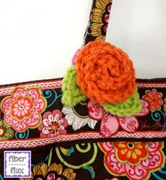 Crochet a couple of these cuties for your summer travels. A simple bloom with a pretty strap makes locating your luggage or bag at th...