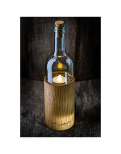 Lamp made from white wine bottle on wooden base with battery powered tea light imitation by SMITALAMPAS on Etsy