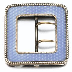 A Fabergé enamel, silver and seed pearl belt buckle, workmaster Michael Perchin, St Petersburg, circa 1895, square, the surface enamelled in translucent powder blue over chevron engine-turning, seed pearl and gilt borders.