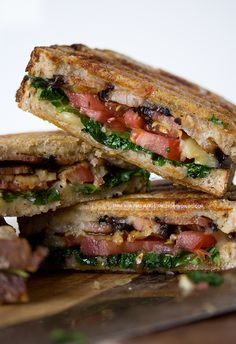 "Eggplant, Lettuce, Tomato,  Bacon Panini  INGREDIENTS: 4 slices of fresh, crusty sourdough bread 1/2 large tomato, sliced 6 slices of bacon 2 handfuls of kale 4 large slices of eggplant, sliced about 1/8"" thick 2 tbsp. olive oil 1/2 cup of Kerrygold Killaree cheddar cheese, shredded (or any type of cheese you prefer) 2 tbsp. unsalted butter, room temperature Salt  pepper"