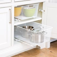 Tackle wasted space and add organization to your kitchen cabinets with gliding cabinet drawers.