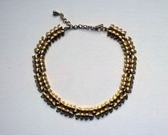 From Grandmama Jensen. ~ ap  Monet vintage choker brushed gold tone with a stylized leaf design.