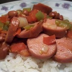 Easy Red Beans and Rice Recipe - This is an easy and delicious take on a Louisiana classic that you can prepare and cook in 40 minutes! I use turkey kielbasa to cut down on the fat, but not the flavor. Rice Recipes, Dinner Recipes, Cooking Recipes, Delicious Recipes, Dinner Ideas, Bean Recipes, Sausage Recipes, Cajun Recipes, Entree Recipes