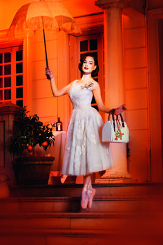 Dita Von Teese looks amazing, as usual, in this photo from a booklet advertising her latest venture with Cointreau: the My Cointreau Evening Bag: a limited edition handbag designed by Dita which includes a bottle of Cointreau, bartender spoon and jigger, recipe notebook, 3 little jars of spices: ginger, cinnamon & chilli, and a powder compact redesigned as an original tea box.