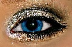 Make your eye color stand out with a bit of glitter eye shadow and black eye liner.