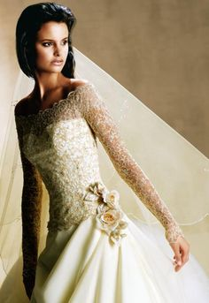 an off-the-shoulder wedding gown with lace sleeves... what a beautiful dress!