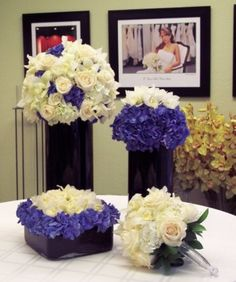 Blue hydrangea, roses, and black cylinders.  It is not for everyone, but for those brides who like this look, its perfect!