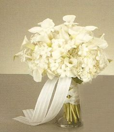 Stephanotis bouquet and boutonniere. See pictures of the lovely stephanotis used in wedding bouquets, corsages, and boutonnieres. Bride Bouquets, Bridesmaid Bouquet, White Wedding Arrangements, White Flowers, Beautiful Flowers, All White Wedding, White Weddings, Dried Rose Petals, Honey