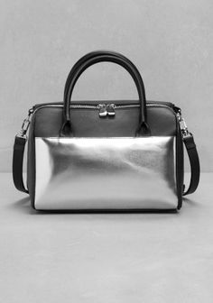 A roomy bowling bag with a chunky, silver-coloured zip and silverish hardware details.