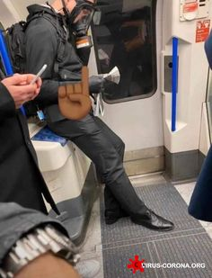 Coronavirus-fearing commuter wears GAS MASK on London tube as experts warn bug could put Brits in hospital - Healthy Worthy Doctor Costume, The Blitz, Plague Doctor, London Underground, London City, Tube, How To Wear, Healthy Tips, Manchester