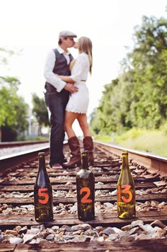 Great idea for a fun save the date: Write the date on wine bottles in the foreground.