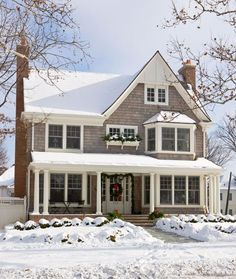 This home's shingle-style architecture looks especially picturesque with a blanket of snow. - Traditional Home ® / Photo: Gordon Beall