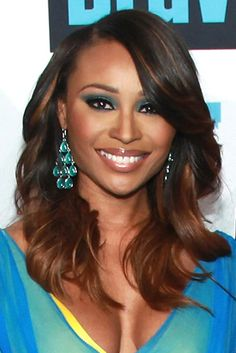 Emerald Eyes - Cynthia Bailey of The Real Housewives of Atlanta attends the 2013 Bravo Upfront wearing dramatic deep teal winged eyeshadow, cinnamon blush and glossy mauve lips. via essence.com