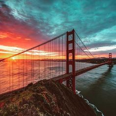 A brilliant, fog-free sunrise graces the Golden Gate Bridge in this photo taken from Golden Gate National Recreation Area in California. On this day in 1937 -- 79 years ago -- this iconic bridge first opened. With towers extending 700 feet into the sky a Baie De San Francisco, San Francisco California, Puente Golden Gate, Travel And Leisure, Golden Gate Bridge, Places To See, San Diego, Beautiful Places, Wonderful Places