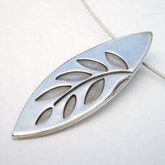 A stunning fine silver leaf shaped pendant with a branch full of leaves.   The pendant has a light patina to make the branch and leaves really stand out.  This fall / autumn pendant measures 4cm in length and 1.5cm at it's widest point. It is hung by a handcrafted fine silver bail which is soldered to the back.  The pendant is hung on a 15 inch choker style sterling silver cable which fastens with a slim sterling silver tube style clasp for a comfortable and secure fit.  This pendant...