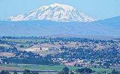 The second highest volcano in the state of Washington, this is Mount Adams at 11,000 feet and change. This guy, has not erupted in over 1,400 years, it is not considered extinct.   The village below is Yakima, Washington. Adams does not get much ink because of Rainier, and Baker, but you can bet your bottom dollar it is an active volcano. Its been sleep for over 1,400 years. Got this on Interstate 82 heading east into Yakima going to Salt Lake City, UT.