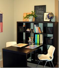Really love the IKEA Expedit shelf/desk setup for a homeschool room. Saw it on their site, and now seeing it again here. Could put a desk attatched on both sides of the shelving if needed...