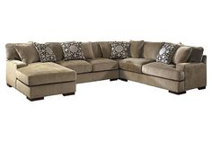 """The Grenada 4-Piece Sectional from Ashley Furniture HomeStore (AFHS.com). With the oversized set-back arms and comfortable pillow back design, the stylish contemporary look of the """"Grenada-Mocha"""" upholstery collection is the perfect fusion of style and comfort with a variety of set up options to suit the needs of any living room."""