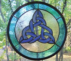 I made this celtic knot panel out of the most amazing iridescent blue glass. It flashes in blues and purples and really is quite extraordinary! I surrounded the central celtic knot in frosty clear glass and gave it a border of slightly textured, translucent turquoise glass that shimmers in the light.  Using the iridescent glass really gives you enjoyment all round the clock. When the sun is bright during the day, the blue of the glass will shine but when the sun sets and you turn the lights…