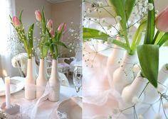 Tulips in white soda bottles