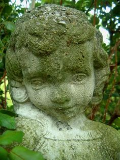 Stained statue of a child.