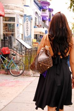 Open back dress and Louis Vuitton Tivoli GM Monogram shoulder bag