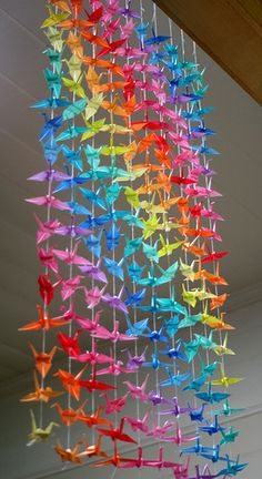 I already know how to make paper cranes, so now I'm wondering if I could do something like this to make a chandelier.  Thoughts?
