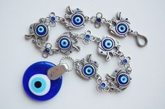 7 Elephant with Evil Eye Beads Amulet Handmade by TheGrandBazaar, $25.00