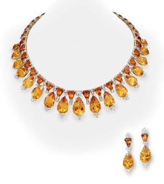 A SUITE OF CITRINE AND DIAMOND JEWELRY   Comprising a necklace, the front designed as a fringe of pear-shaped citrines with rose-cut diamond trefoil accents, suspended from a graduated hexagon-cut citrine and rose-cut diamond band; and a pair of ear pendants en suite, mounted in 18k white and yellow gold, necklace 15½ ins.