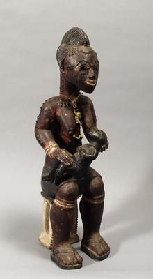 Female figure with child  (572)     Female figure with child. West Africa, Ivory Coast: Baule. 20th century. Wood, beads. h. 45.7 x w. 14.2 x d. 14.8 cm. Acquired 1974. Robert and Lisa Sainsbury Collection. UEA 572