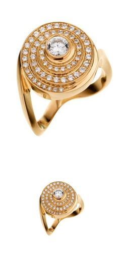 Sophie Bille Brahe Escargot ring with a centrally set diamond surrounded by a halo of further diamonds.