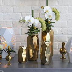 Looking for modern gold wedding containers? Check out this chic Maven ceramic cylinder vase with an oval shape. Create a stunning DIY floral arrangement with this unique geometric vase for a dramatic